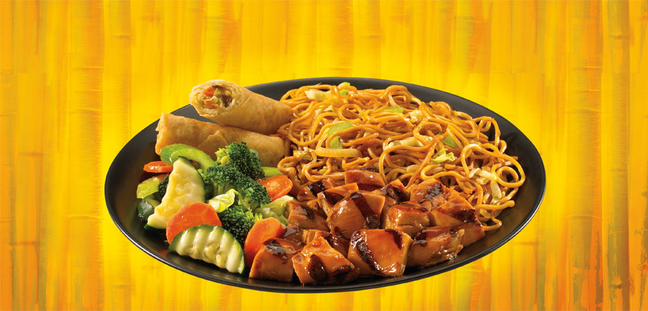 Plate of Chinese food, noodles, chicken, veggies and egg roll