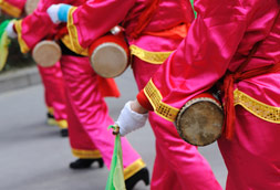 People in colorful outfits with drums