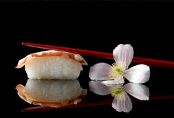 Sushi with chop-sticks and flower